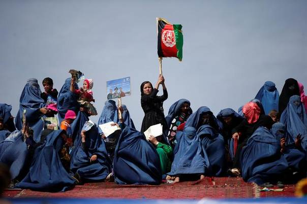 Supporters of Afghan presidential candidate Ashraf Ghani Ahmadzai attend an election campaign in Kunduz province, northern Afghanistan March 19, 2014. The Afghan presidential elections will be held on April 5. REUTERS/Ahmad Masood