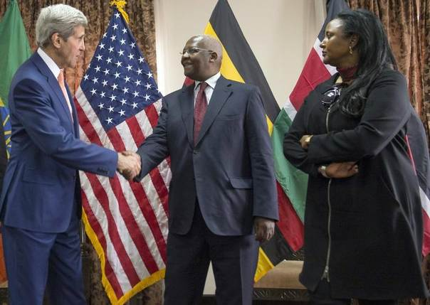 U.S. Secretary of State John Kerry (L) shakes hands with Ugandan Foreign Affairs Minister Sam Kutesa (C) as Kenyan Foreign Minister Amina Mohamed looks on after meetings at the Ethiopian Minister of Foreign Affairs in Addis Ababa, Ethiopia, May 1, 2014. REUTERS/Saul Loeb/Pool