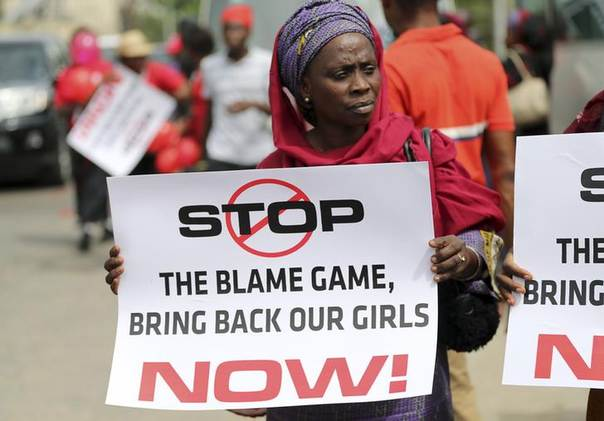 A woman carries a sign as she attends a protest demanding the release of abducted secondary school girls in the remote village of Chibok, in Lagos May 9, 2014. REUTERS/Akintunde Akinleye