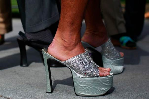 A man wears high heels for the 10th annual Walk A Mile In Her Shoes to raise awareness against sexual violence in San Jose, California, on April 18, 2012. REUTERS/Stephen Lam