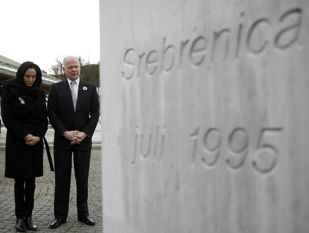 Britain's Foreign Secretary William Hague and U.S. actress Angelina Jolie stand in front of the Srebrenica Genocide Memorial in Potocari after laying a wreath March 28, 2014. REUTERS/Dado Ruvic