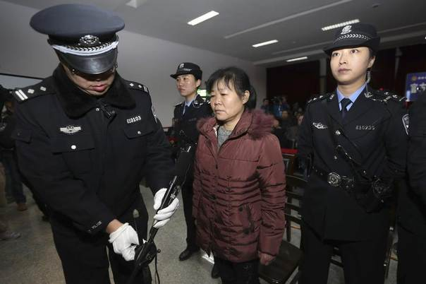Zhang Shuxia, an obstetrician involved in baby trafficking, stands trial in Weinan Intermediate People's Court in Weinan, Shaanxi province, China, December 30, 2013. REUTERS/China Daily