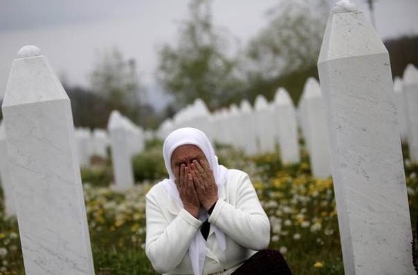 Mejra Dzogaz cries near the graves of her family members at the Memorial Center in Potocari April 7, 2014. REUTERS/Dado Ruvic