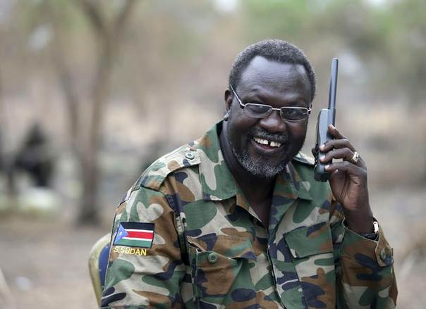 South Sudan's rebel leader Riek Machar talks on the phone in his field office in a rebel controlled territory in Jonglei State February 1, 2014. REUTERS/Goran Tomasevic