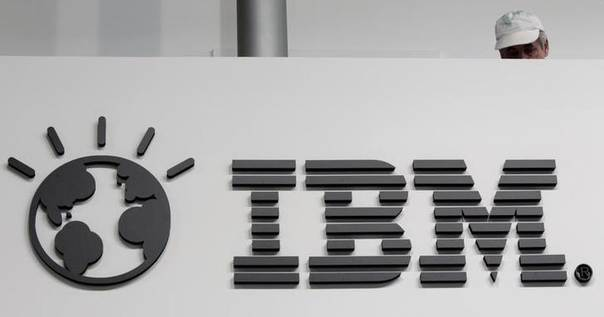 A worker is pictured behind a logo at the IBM stand on the CeBIT computer fair in Hanover February 26, 2011 REUTERS/Tobias Schwarz
