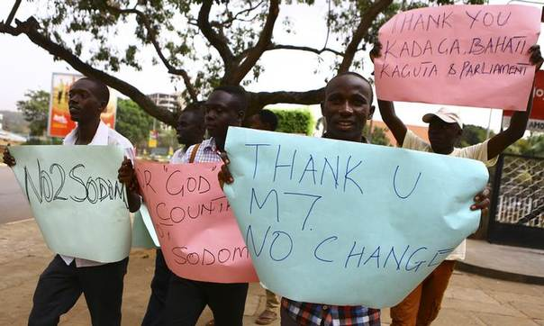 Anti-gay supporters celebrate after Uganda's President Yoweri Museveni signed a law imposing harsh penalties for homosexuality in Kampala February 24, 2014 REUTERS/Edward Echwalu