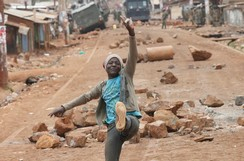 A supporter of opposition leader Raila Odinga gestures in front of a barricade in Kawangware slum in Nairobi, Kenya, August 10, 2017