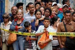 Eight electrocuted in Caracas looting amid Venezuela protests- firefighter