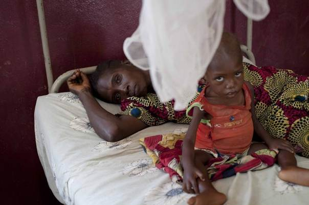 A mother and her child, who is suffering from malnutrition, share a bed at a paediatrics hospital in Bangui, Central African Republic, February 25, 2014. REUTERS/Camille Lepage