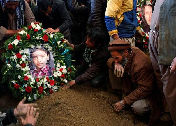 A picture of Nilofar, daughter of Afghan journalist Sardar Ahmad of Agence France Presse, is placed on her grave in Kabul March 23, 2014. Sardar, his wife and two children were killed during an attack by gunmen at Serena Hotel on Thursday. REUTERS/Ahmad Masood
