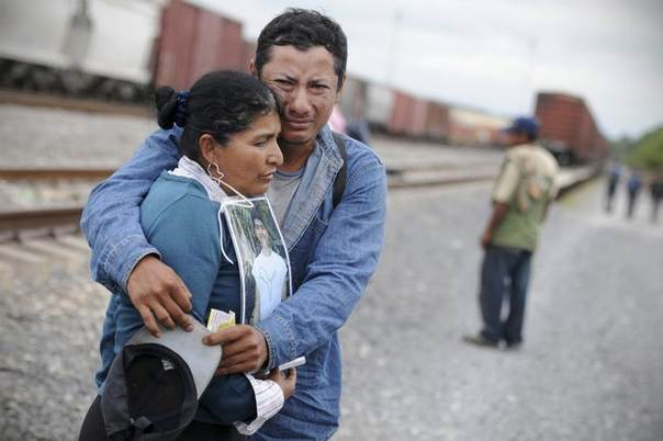 A Central American illegal migrant hugs a woman carrying a photo of her son, who disappeared on his way through Mexico to the U.S., in Tierra Blanca, in the Mexican state of Veracruz. Picture October 29, 2012. REUTERS/Yahir Ceballos