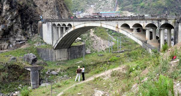 The Phulping bridge crosses the Bhote Koshi River in Jhirpu Phulpingkatti, a village near Nepal's border with China. It replaced an old stone bridge, remnants of which can be seen to the left, which was washed away in the floods of 1981. THOMSON REUTERS FOUNDATION/Saleem Shaikh