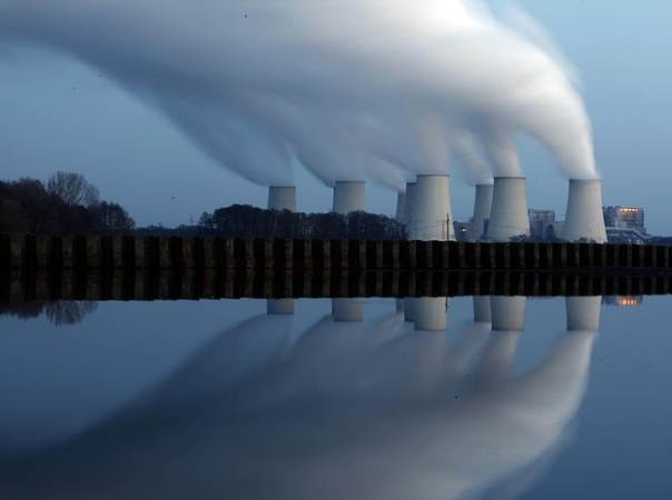 Steam billowing from the cooling towers of Vattenfall's Jaenschwalde brown coal power station is reflected in a lake near Cottbus, eastern Germany in this photo from December 2009. REUTERS/Pawel Kopczynski