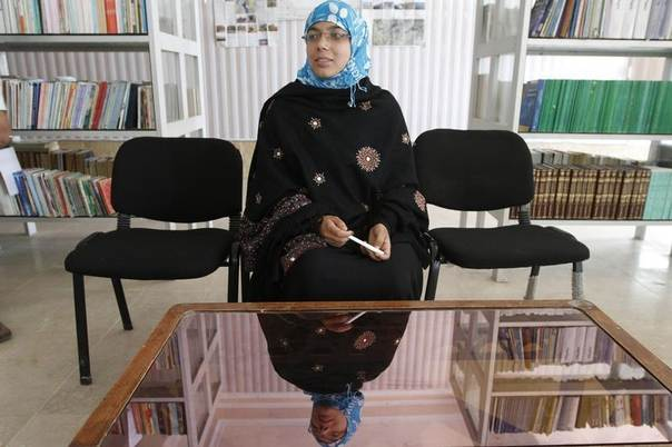 Serena Faizi, 25, one of the provincial candidate elections from Kandahar, sits at a public library in Kandahar province, Afghanistan, April 14, 2014. REUTERS/ Ahmad Nadeem