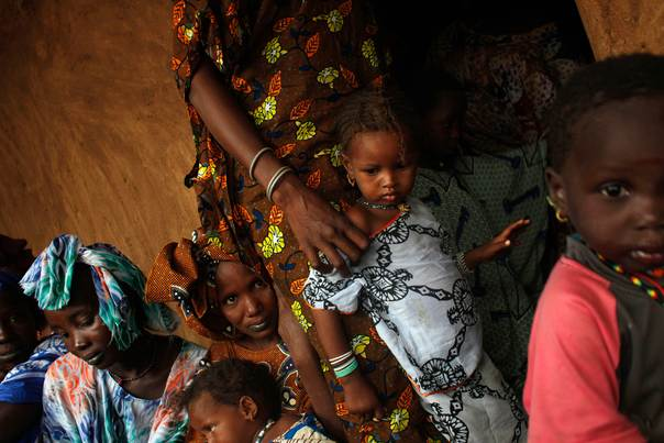 Women and children take part in a talk with members of the Spanish Non-Governmental Organization Accion contra el Hambre (Action against hunger) about good sanitation and hygiene practices in Niomel, in the Guidimakha region, Mauritania, on June 3, 2012. REUTERS/Susana Vera