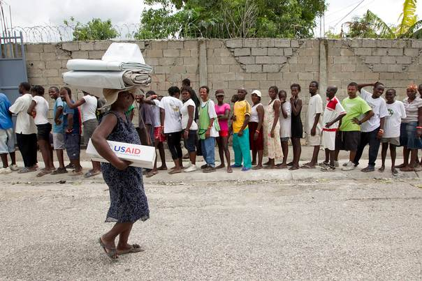Residents stand in line to receive aid from International Organization for Migration (IOM) in a camp for displaced people in Port-Au-Prince, Haiti on August 26, 2012. REUTERS/UN/MINUSTAH/Logan Abassi/Handout