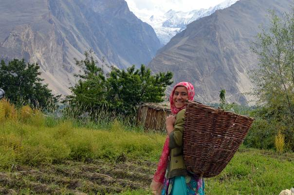 A young mountain farmer with a basket tied to her back heads towards her potato field in Karimabad village in the northern province of Gilgit-Baltistan, Pakistan. THOMSON REUTERS FOUNDATION/Saleem Shaikh