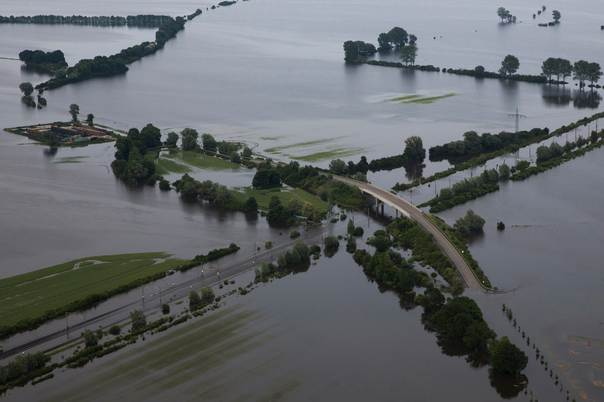 A picture shows the 107 highway crossing a train line inundated by the Elbe river near the village of Schoenhausen, in the federal state of Saxony Anhalt, Germany, on June 12, 2013. REUTERS/Thomas Peter