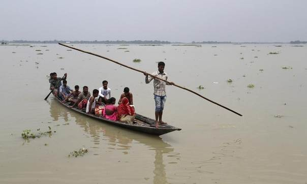 Villagers move to safer places through flooded areas of Morigaon district in the northeastern Indian state of Assam, Aug. 19, 2014. REUTERS/Stringer