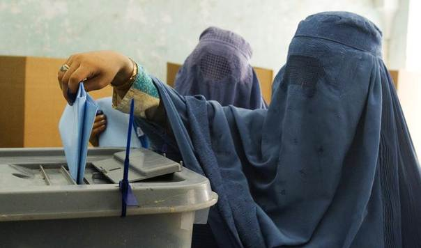 Women cast their ballots at a polling station in Herat, western Afghanistan, during a parliamentary election in September 2010. REUTERS/Raheb Homavandi