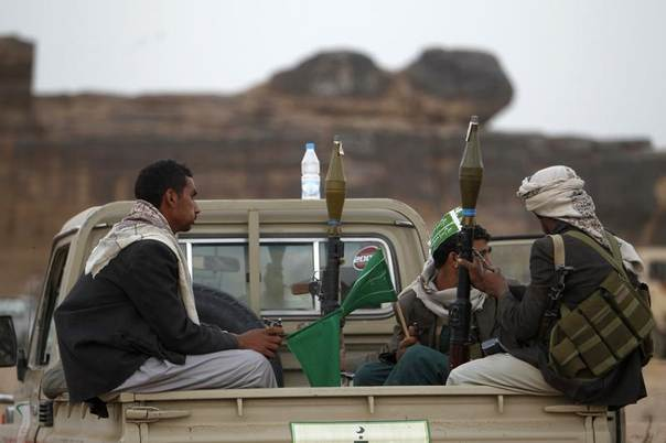 Armed followers of Yemen's Shi'ite Houthi group sit on a truck patrolling the vicinity of a ceremony attended by fellow Shi'ites in Dhahian of the northwestern Yemeni province of Saada February 3, 2012.  REUTERS/Khaled Abdullah