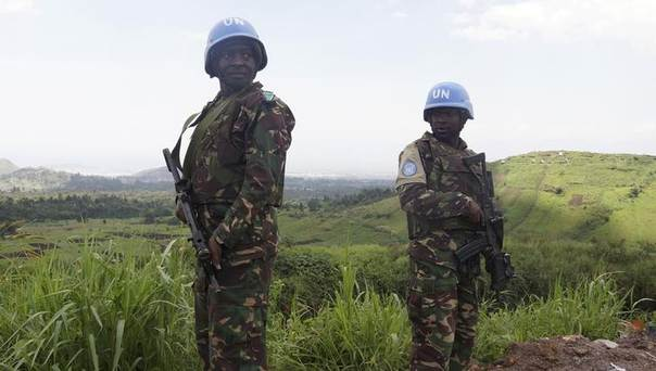 In this 2013 file photo, U.N. peacekeepers from Tanzania hold their weapons as they patrol outside Goma during a visit by officials from the U.N. Security Council in the eastern Democratic Republic of Congo REUTERS/Kenny Katombe
