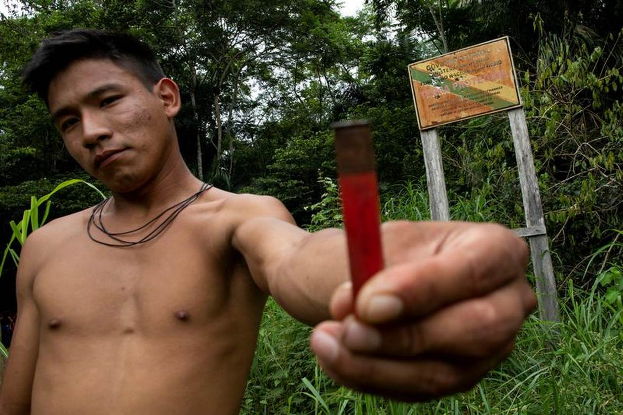 Boatuto, a man from the Uru-eu-wau-wau tribe, shows an ammunition capsule which had been fired into an official Funai sign at the Uru-eu-wau-wau Indigenous Reservation. Picture taken January 31, 2019. REUTERS/Ueslei Marcelino