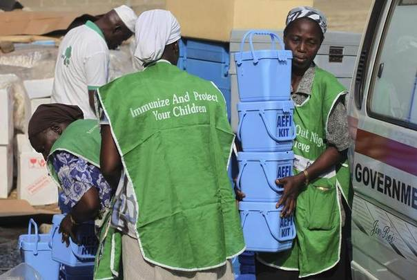 Local health workers carry vaccination kits at a distribution centre ahead of the start of a nationwide polio immunization campaign on Wednesday, in Lagos February 21, 2011. REUTERS/Akintunde Akinleye