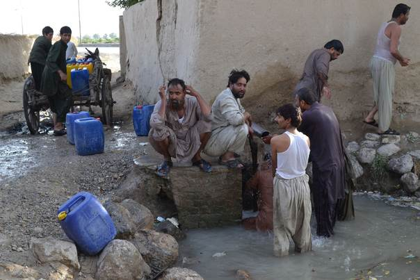 Men wash and boys collect water in Quetta, the provincial capital of Pakistan's Baluchistan province. Quetta has been facing acute water shortages for the last six years as underground supplies deplete. THOMSON REUTERS FOUNDATION/Aamir Saeed