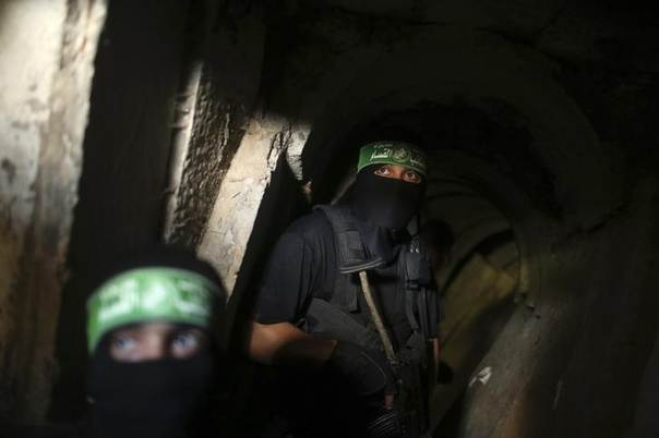 Palestinian fighters from the Izz el-Deen al-Qassam Brigades, the armed wing of the Hamas movement, are seen inside an underground tunnel in Gaza August 18, 2014. REUTERS/Mohammed Salem