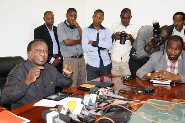 Tanzania's Transport Minister Harrison Mwakyembe briefing reporters on suspension of 13 airport officials, July 2, 2014, Dar es Salaam. Photo by Issa Michuzi.