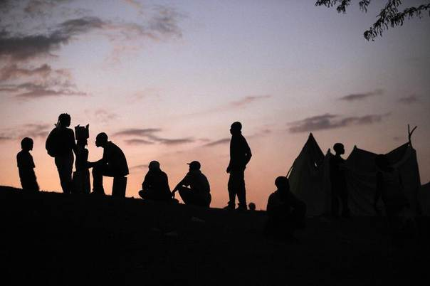Archive photo: Earthquake survivors gather outside a tent during sunset in a camp on the golf course in Port-au-Prince, January 18, 2010. REUTERS/Jorge Silva