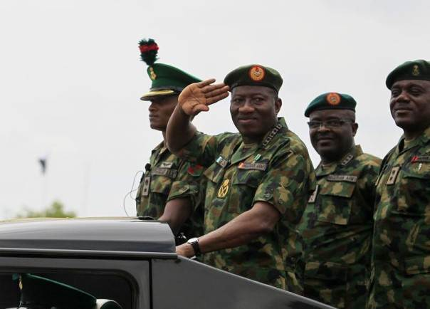 Nigeria's President Goodluck Jonathan salutes as he parades during the Nigeria Army's 150th anniversary celebration in Abuja, July 6, 2013. REUTERS/Afolabi Sotunde