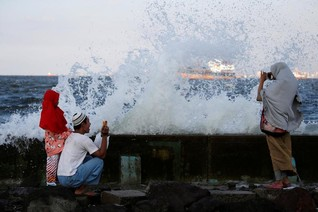 Crumbling seawall heightens worries over flood threat to Indonesian capital