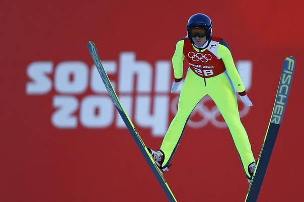 Austria's Daniela Iraschko-Stolz soars through the air during the women's ski jumping individual normal hill training event of the Sochi 2014 Winter Olympic Games, at the RusSki Gorki Ski Jumping Center in Rosa Khutor, February 8, 2014. REUTERS/Michael Dalder