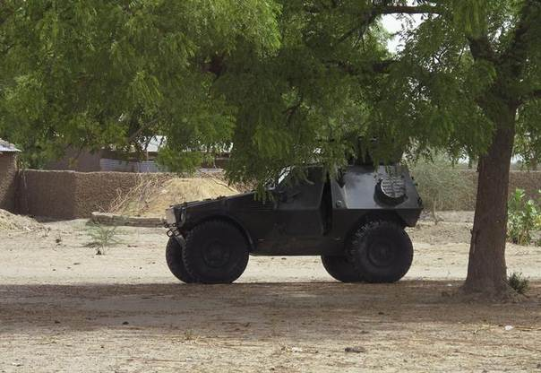 A military armoured vehicle is stationed under a tree during a military patrol in Hausari village, near Maiduguri, Nigeria, June 5, 2013. REUTERS/Joe Brock