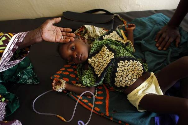 Two-year-old Aissata Dia is tended by her grandmother as she recovers from malnutrition and malaria at a nutrition centre at Selibaby's hospital, in Mauritania's Guidimakha region. Photo June 3, 2012. REUTERS/Susana Vera