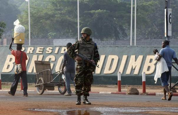 A Moroccan soldier from the peacekeeping forces secures a street in Bangui, Central African Republic, February 20, 2014. REUTERS/Luc Gnago