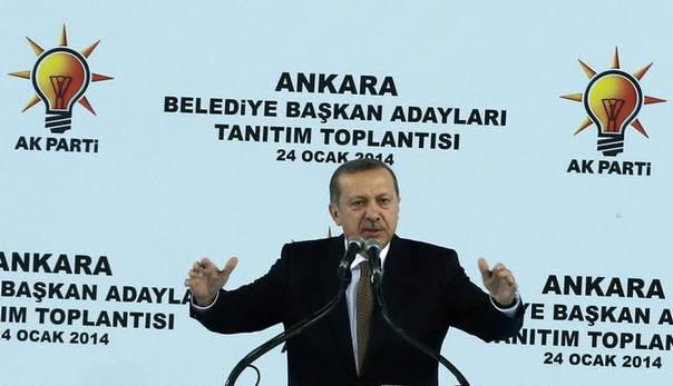 Turkey's Prime Minister Tayyip Erdogan addresses his supporters during a meeting of the ruling AK Party (AKP) in Ankara January 24, 2014 REUTERS/Umit Bektas
