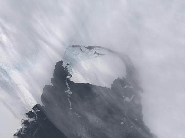 The B-31 Iceberg is seen after separating from a rift in Antarctica's Pine Island Glacier in this NASA Earth Observatory handout image acquired on Nov. 13, 2013. REUTERS/NASA Earth Observatory/Holli Riebeek/Handout via Reuters