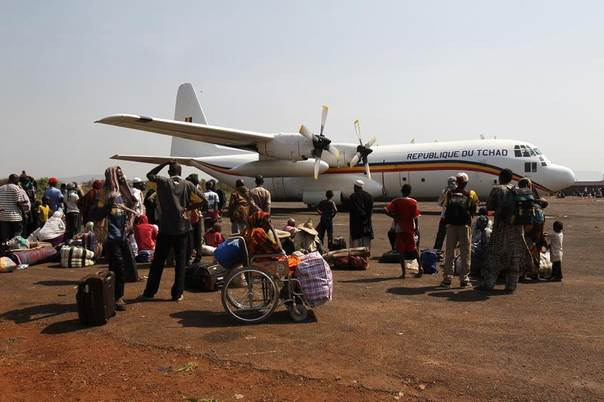 Muslims gather at a camp for displaced people at Mpoko international airport in Bangui, CAR< as they wait to leave the capital, February 13, 2014. REUTERS/Luc Gnago