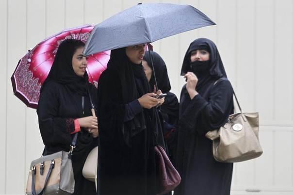 Women hold umbrellas on a rainy day in Riyadh November 19, 2013. REUTERS/Faisal Al Nasser