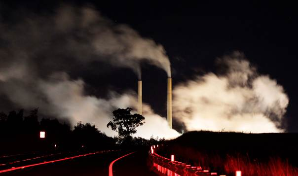 Steam and other emissions rise from a coal-fired power station near Lithgow, 120 km (75 miles) west of Sydney, on July 7, 2011. REUTERS/Daniel Munoz