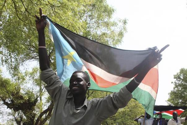 A man holding South Sudan's flag cheers during a rally, in support of President Salva Kiir's administration, in Juba March 10, 2014. REUTERS/Andreea Campeanu