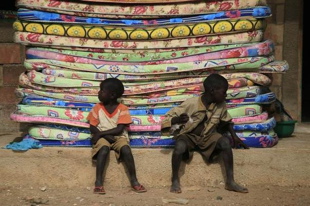 Boys sit in front of a pile of mattresses at LEA primary school Bondon, Kaura local government Kaduna State, Nigeria, March 20, 2014. REUTERS/Afolabi Sotunde