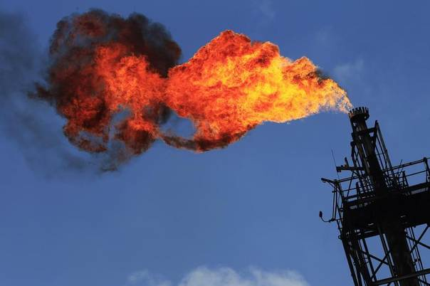 Excess natural gas is flared, or burned off, at a flare stack at a refinery in Tula, Mexico, Nov. 21, 2013. REUTERS/Henry Romero