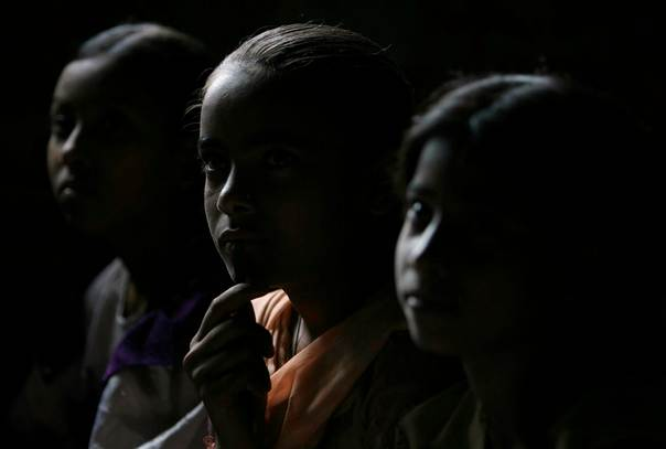 In a 2007 file photo, Sheema Mandal (C), a 12-year-old house servant, attends a class at a school for child labourers in the north-eastern Indian city of Siliguri. REUTERS/Rupak De Chowdhuri