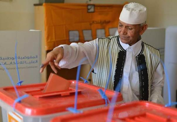 A voter places his ballot paper in the box at a polling station inside a school in Sabha, southern Libya, June 25, 2014. REUTERS/Saddam Alrashdy
