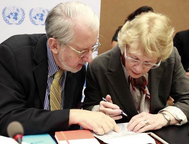 Karen Koning Abuzayd (R), member of the International Commission of Inquiry on Syria for the United Nations Human Rights Council talks to commission chairperson Paulo Pinheiro before a news conference on the presentation of their latest report at the U.N. In Geneva June 3, 2013. REUTERS/Ruben Sprich