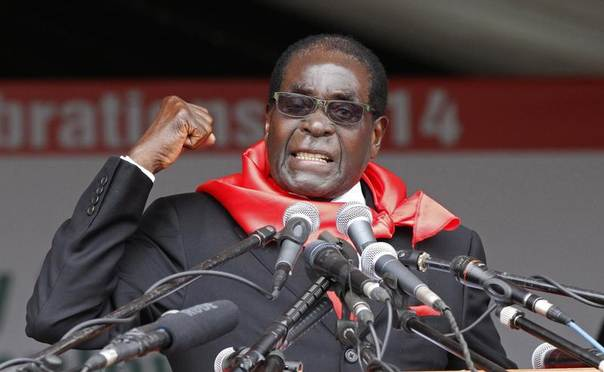 Zimbabwe President Robert Mugabe addresses supporters during celebrations to mark his 90th birthday in Marondera about 80km (50 miles) east of the capital Harare, February 23, 2014.